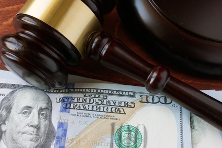 bail: A gavel and currency on a table.