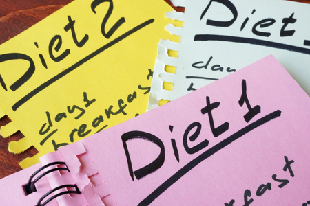 fat food: Papers with meal plan and title Diet.