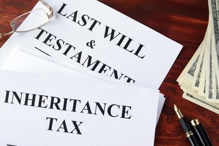 Inheritance tax form on a table and cash. Stock Photo