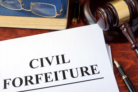Civil forfeiture, documents and gavel on a table.