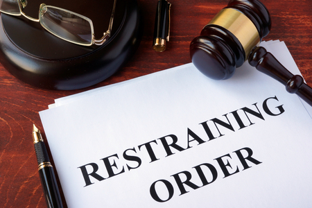 Restraining order and gavel on a table. Stockfoto