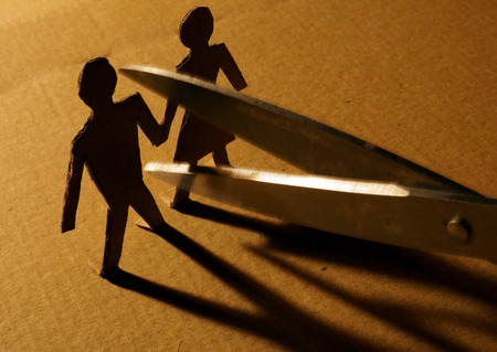 Figures of couple from paper and scissors. Stockfoto