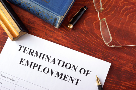 Termination of employment form on a wooden surface. Imagens - 70341774