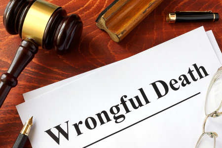wrongful: Document with title Wrongful Death o a wooden surface.