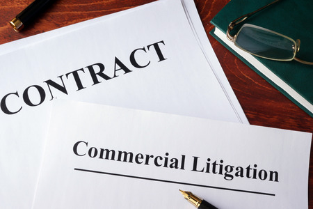 commercial: Commercial litigation form and contract on a table.