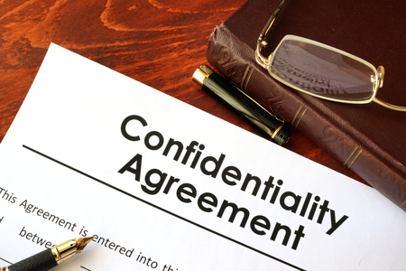 Confidentiality Agreement form on a table. Non-disclosure contract. Stock Photo