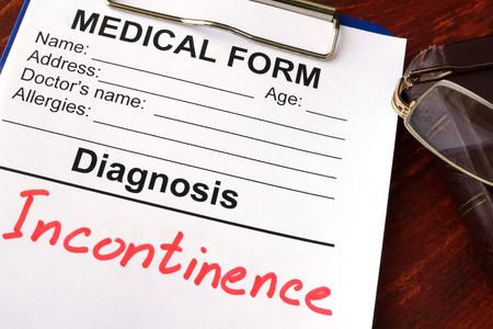 incontinence: Medical form with diagnosis Incontinence on a table.