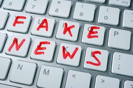 Words fake news written on a keyboard. Stok Fotoğraf