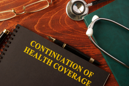 continuation: Book with title Continuation of Health Coverage. Stock Photo