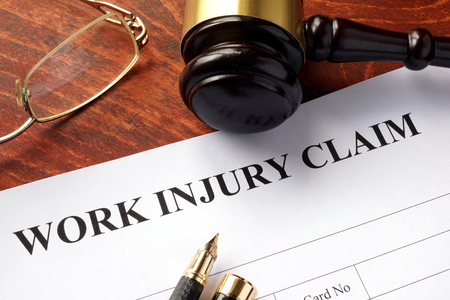 work worker: Worker compensation. Work injury claim on a table. Stock Photo