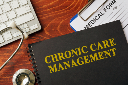 Pain Management: Book with title chronic care management on a table. Pain management concept.