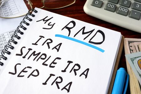 My RMD (Required Minimum Distributions) IRA, SIMPLE IRA, SEP IRA written in a notebook. Banco de Imagens