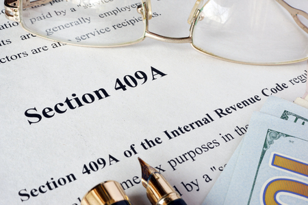 irc: Internal Revenue Code section 409A written in a document. Stock Photo