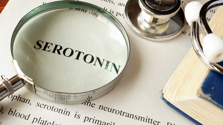 Serotonin written on a page. Human hormones.
