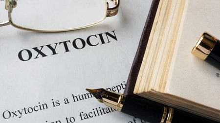 oxytocin: Oxytocin written on a page. Human hormones.