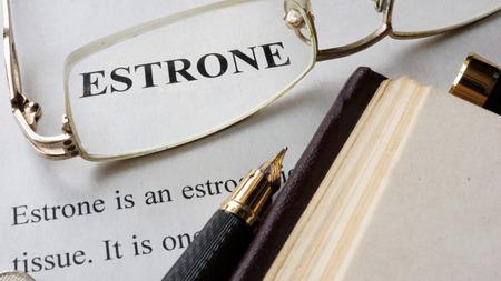 bio medicine: Paper with word Estrone and a book.