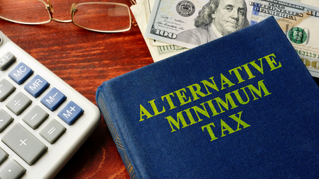 Book with title Alternative Minimum Tax (AMT). Banco de Imagens