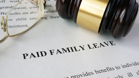 Page with title Paid family leave and gavel. Foto de archivo
