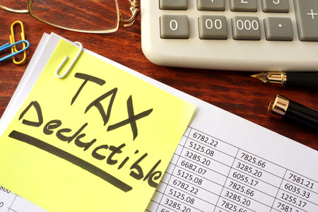 tax: Sticker with title tax deductible and financial documents.