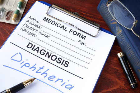 diphtheria: Medical form with diagnosis Diphtheria in a hospital.