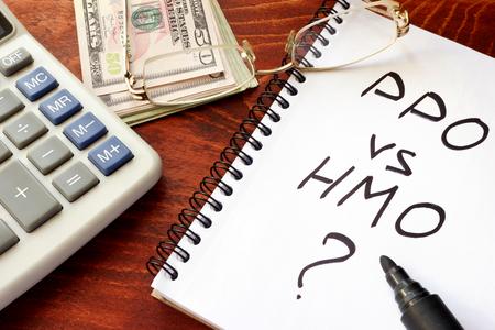 PPO vs HMO written in a note. Healthcare insurance concept. Stock Photo