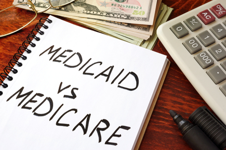 Medicaid vs Medicare written in a note. Health insurance concept.