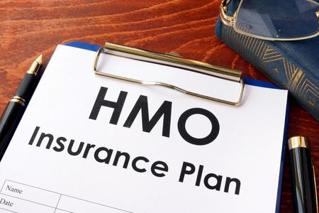 HMO Insurance Plan on a table. (Health Maintenance Organization) Stock Photo