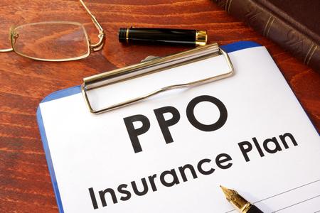 PPO Insurance Plan on a table. (Preferred Provider Organization)