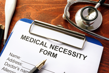 necessity: Medical Necessity form on a table. Stock Photo