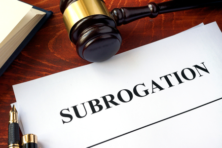 Document with title subrogation and gavel.