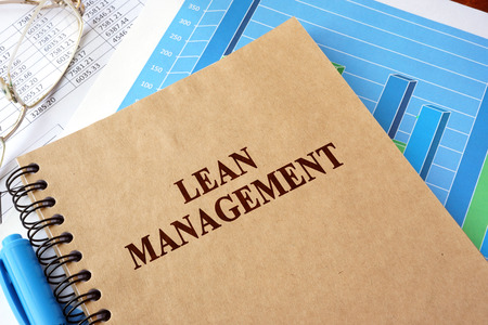 Book with title lean management on a table.