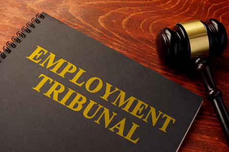 Book with title employment tribunal on a table. Archivio Fotografico