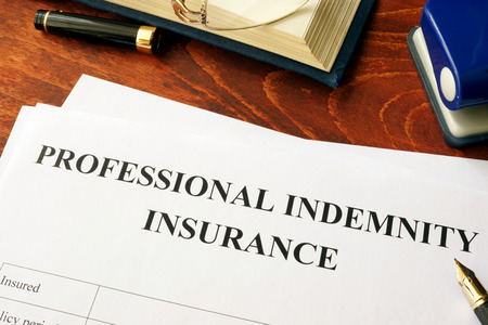 Professional indemnity insurance policy on a table.