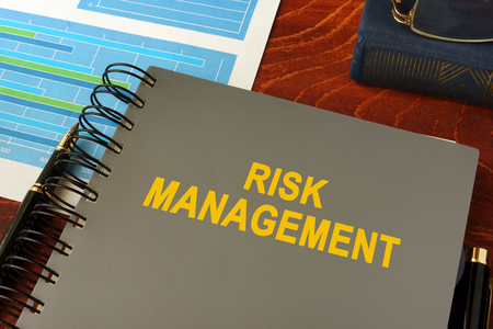 Book with title risk management in an office.