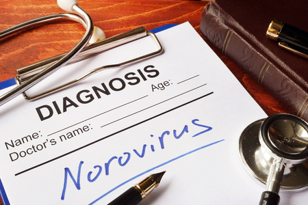 norovirus: Medical form with diagnosis Norovirus on a table. Stock Photo