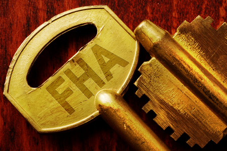 loaning: Abbreviation FHA on a key. Real estate loan concept. Stock Photo