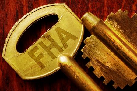 Abbreviation FHA on a key. Real estate loan concept. Banque d'images