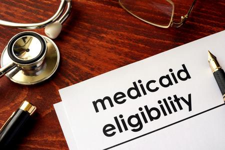 eligibility: Document with title medicaid eligibility. Stock Photo
