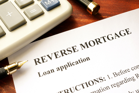 reverse: Reverse mortgage loan application on a table.