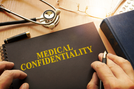 Document with name medical confidentiality on a table.
