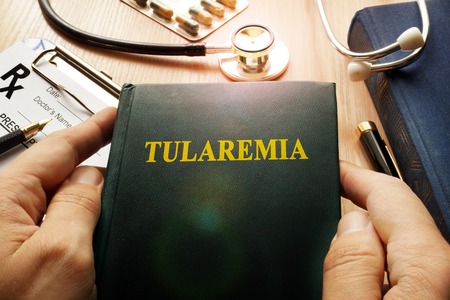 transmissible: Book with title Tularemia in a hospital. Stock Photo