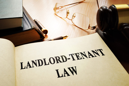 Landlord-tenant law on an office table. Stockfoto