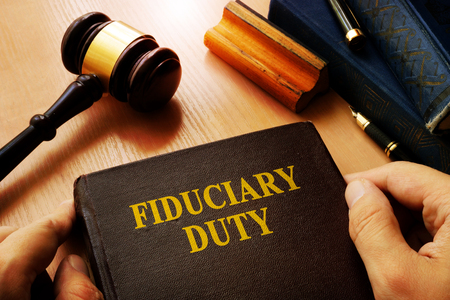 Hands holding Fiduciary duty in an court. Archivio Fotografico
