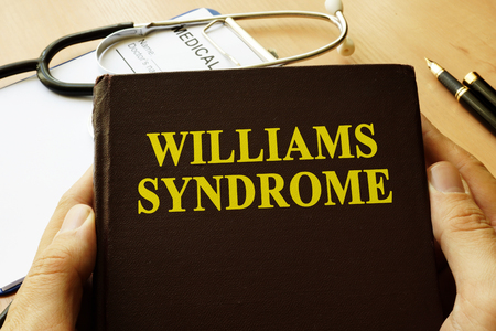 Book with title Williams Syndrome on a table. Reklamní fotografie - 80035800