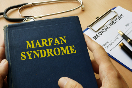 Book with title Marfan Syndrome on a table.