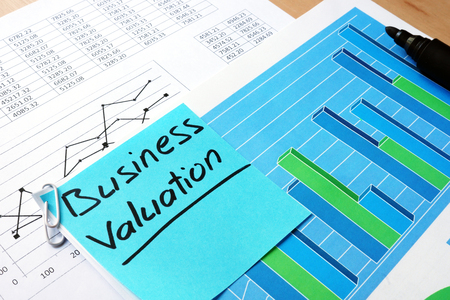 Piece of paper with words business valuation and financial data.