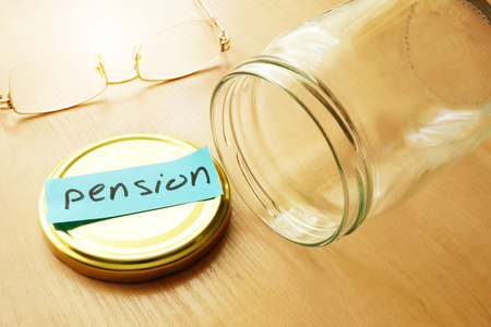Empty jar with label pension. Retirement saving troubles concept. Imagens