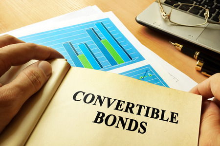 Book with page about convertible bonds.