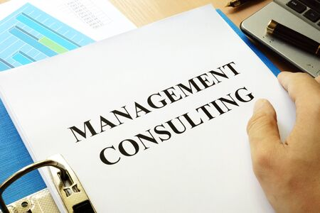 advice: Folder and papers with title Management consulting.