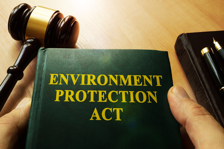 Hands holding environment protection act in a court. Stock Photo